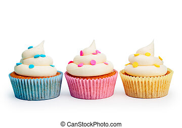 Three colorful cupcakes isolated against white