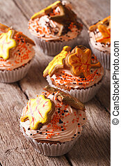 Cupcakes with autumn leaves close up on the table. vertical