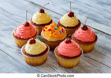 Cupcakes with bright frosting.