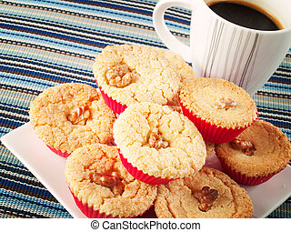Cupcakes with cup of coffee