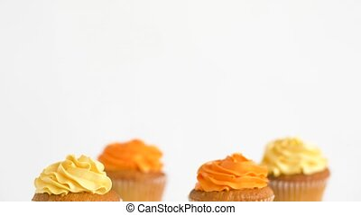 cupcakes with frosting on confectionery stands