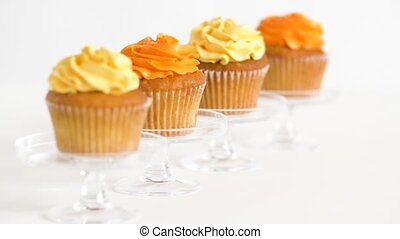 cupcakes with frosting on confectionery stands - food, ...