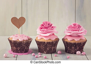 Cupcakes with heart cakepick