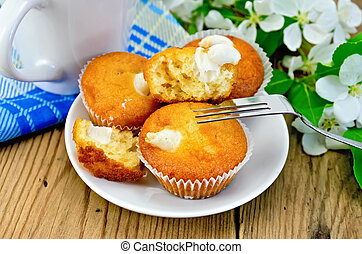 Cupcakes with sweet cream on a plate