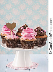 Cupcakes with sweet rose flowers