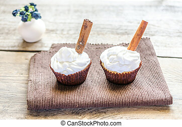 Cupcakes with whipped cream and cinnamon