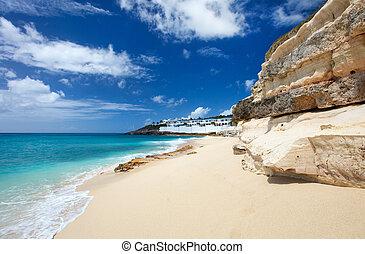 Cupecoy Beach on St Martin Caribbean - Sandstone cliffs at...