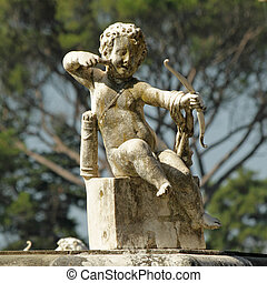 cupid with arrow and bow - detail from fountain in Boboli...