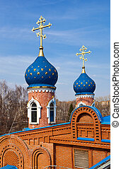 Cupolas of Russian orthodox church against blue sky