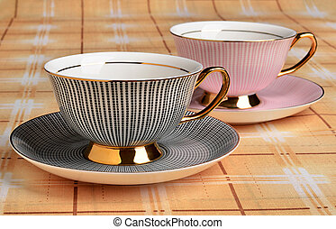 Cups and saucers for tea on the table
