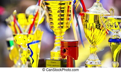 Cups for the winners. Exhibition tuned cars
