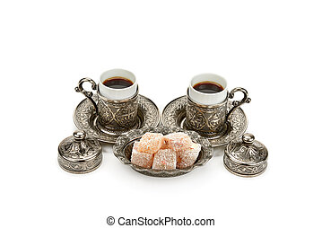 Cups of coffee and turkish delight in vase isolated on white background.