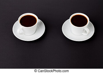 cups of coffee on a black background
