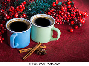 Cups of fragrant coffee on a Christmas background of fir...