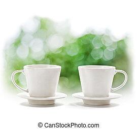 Cups on defocus summer background