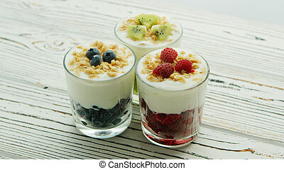 Cups with berries and cream