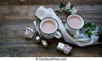 Cups with cocoa and pieces of marshmallow