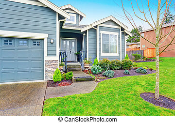 Curb appeal. House exterior with garage and driveway - Curb ...