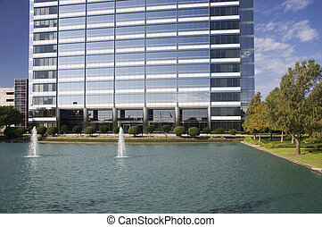 Curb Appeal - Modern office building with water and...