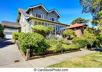 Curb appeal. Two story house with garage and driveway
