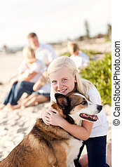 Cure Girl Playing with Her Dog at the Beach.