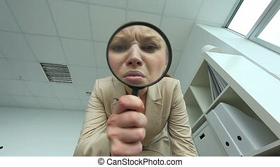 Curiosity - Pretty woman looking through spy glass in office