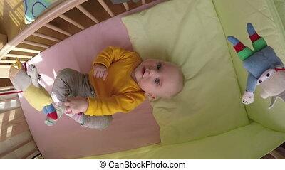 curious baby carousel - Curious newborn baby look at...
