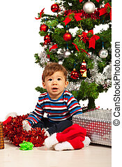 Curious baby in front of Xmas tree