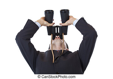Curious businessman holds binoculars up to the sky. Isolated...