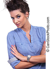 curious casual woman with folded arms