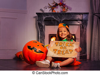 Curious Halloween girl with trick or treat sign