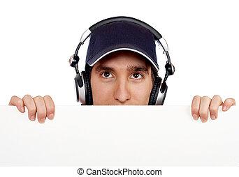 Curious handsome disc jockey - Handsome disc jockey behind ...