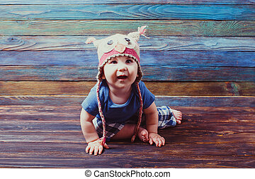 curious little baby in a funny hat