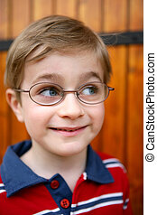 Curious little boy wearing glasses