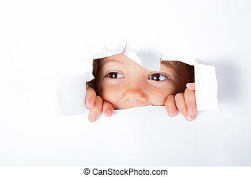 Curious child emerge from the paper