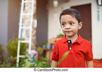 Curious little latino boy kid