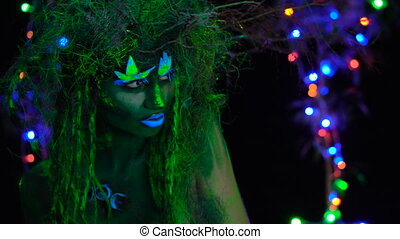 Curious Mystic green dryad in UV fluor black light with...