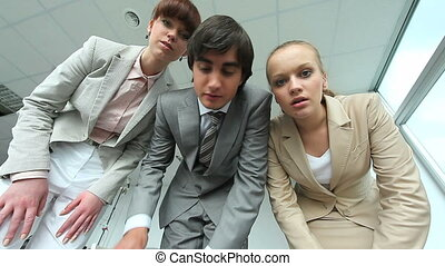 Curious people - Three managers inspecting something and...