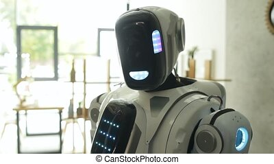 Curious robot looking into camera - Technological...