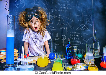 curious science - Funny little girl doing experiments in the...