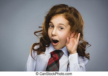 Curious smiling girl listens. Closeup portrait child hearing...