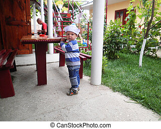 Curious toddler in the courtyard of