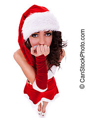 curious woman in christmas clothes - closeup picture of a...