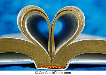 Bible page curled in a heart shape.