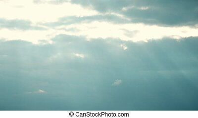 Curling clouds and rays of sun time lapse