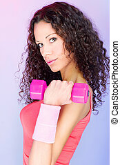 curls hair girl holding weight for exercise