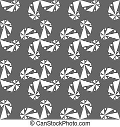 Curls of geometric shapes on a gray background.