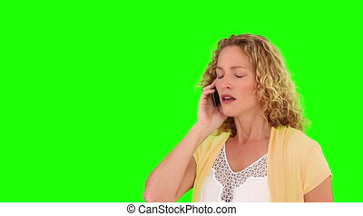 Curly blond haired having a phone call