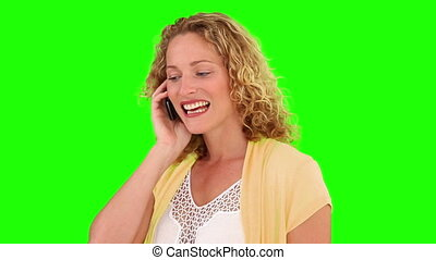 Curly blond haired woman having a phone call