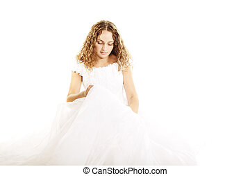 Curly bride in wedding dress